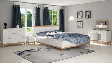 Skandynawskie meble do sypialni w kolorze białym na drewnianych nóżkach