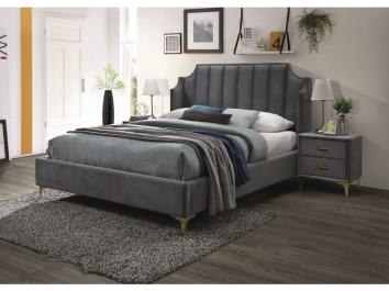Duża sypialnia z szarymi meblami tapicerowanymi na nóżkach