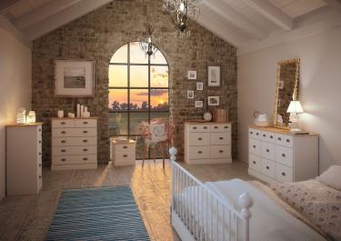Białe komody w stylu prowansalskim na tle ceglanej ściany