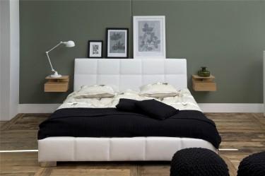 Nowoczesna sypialnia z białym łóżkiem z pikowanej ekoskóry i ciemnozielonymi ścianami
