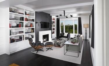 Stylowy salon w biało-czarnych kolorach z nowoczesnym kominkiem