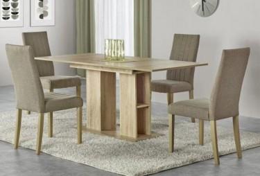 Wnętrze jadalniane uzupełnione w rozkładany stół i tapicerowane krzesła na kremowym dywanie