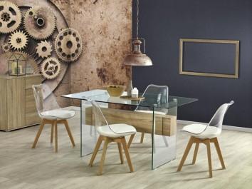 Szklany stół z ozdobną belką i krzesła z poduszką na siedzisku
