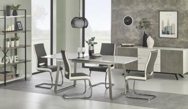 Jadalnia z zestawem mebli w kolorze szarym i imitującym strukturę betonu