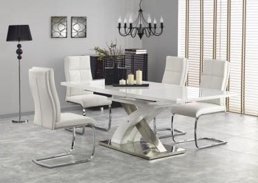Rozkładany stół w wysokim połysku na designerskiej podstawie w towarzystwie wygodnych krzeseł z pikowanej ekoskóry