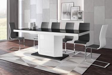 Czarno-biały stół z rozkładanym blatem w towarzystwie krzeseł z ekoskóry w nowoczesnej jadalni z drewnianą podłogą