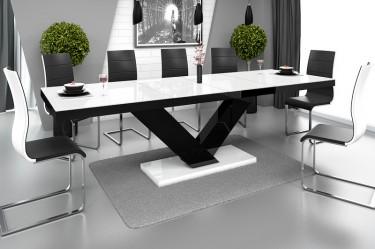 Nowoczesna jadalnia z dekoracyjną ścianą wyposażona w rozkładany stół w wysokim połysku i krzesła ze skóry ekologicznej