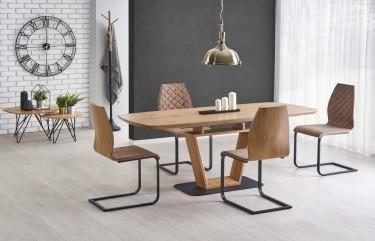 Rozkładany stół w nowoczesnej jadalni z krzesłami na metalowych płozach w towarzystwie białych i szarych ścian