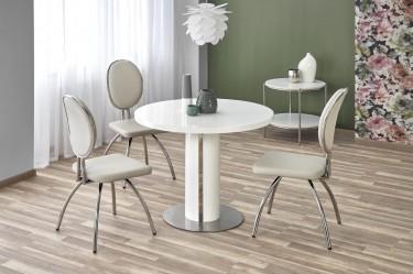 Okrągły stół w wysokim połysku w towarzystwie tapicerowanych krzeseł w nowoczesnej jadalni