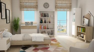 Meble w stylu skandynawskim na tle kolorowego dywanu i jasnych ścian w sypialni z oknem i balkonem