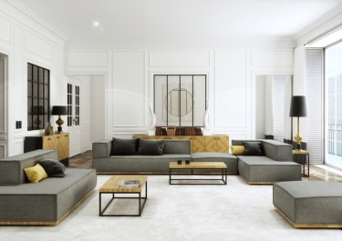 Wypoczynkowe meble modułowe i stoliki industrialne w salonie z dużym oknem, jasnym dywanem i lustrem