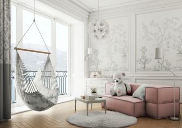 Tapicerowana sofa modułowa w kolorze różowym i biały stolik kawowy