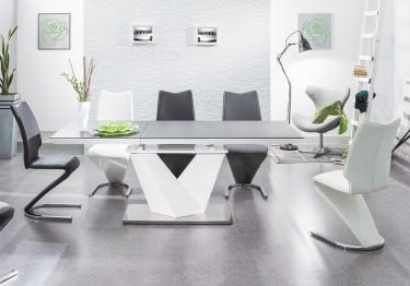 Krzesła tapicerowane ekoskórą i biały rozkładany stół z blatem ze szkła hartowanego