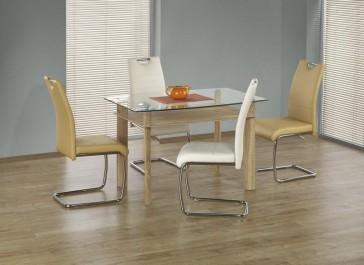 Krzesła na płozach tapicerowane ekoskórą z rączką ułatwiającą ich odsuwanie od stołu