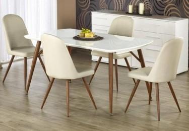 Stół z rozkładanym blatem w wysokim połysku i krzesła tapicerowane kremową skórą ekologiczną