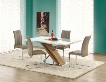 Lakierowany stół z nakładką szklaną na blacie i krzesła na płozach pokryte skórą ekologiczną