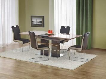 Rozkładany stół w wysokim połysku na ozdobnej podstawie z krzesłami na płozach i z rączką ułatwiającą odsuwanie od stołu
