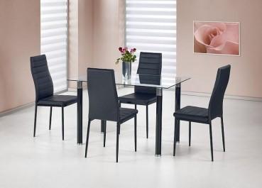 Krzesła tapicerowane ekoskórą w towarzystwie stołu ze szklanym blatem w jadalni z różowymi ścianami i dużym obrazem