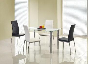 Szklany stół na metalowych rurkach z czarnymi i białymi krzesłami ze skóry ekologicznej