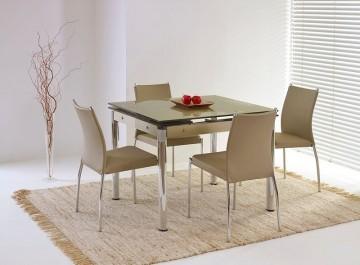 Rozkładany stół ze szklanym blatem i krzesła na metalowych nogach bez podłokietników