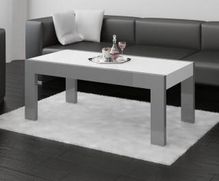 Ława z białym blatem w wysokim połysku w salonie jako uzupełnienie czarnej, skórzanej sofy