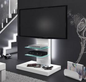 Biały stolik RTV w wysokim połysku z podświetlanymi półkami z lakierowanego szkła na tle ściany pomalowanej ciemną farbą