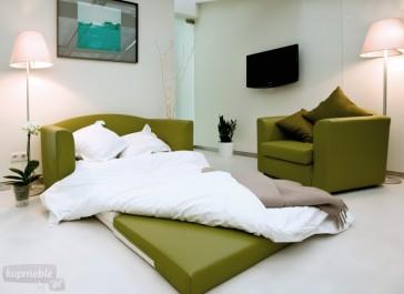 Nowoczesna sofa z funkcją spania tapicerowana zieloną skórą ekologiczną