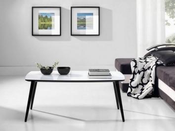 Prostokątny stolik kawowy z blatem ze szkła hartowanego na czarnych drewnianych nogach