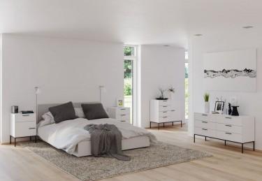 Białe meble do sypialni na wysokich nóżkach z metalu malowanego na czarno