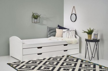 Białe łóżko z funkcją dodatkowego miejsca snu oraz stolik z okrągłym blatem w stylu industrialnym
