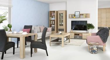 Jadalnia połączona z salonem wyposażona w minimalistyczne meble w dekorze drewnianym