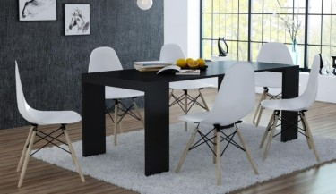 Wielofunkcyjny rozkładany stół w wykończeniu matowym i krzesła z tworzywa sztucznego na drewnianych nogach