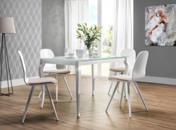 Biały stół z blatem ze szkła hartowanego oraz krzesła z drewna bukowego z tapicerowanym siedziskiem