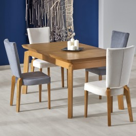 Rozkładany stół z blatem w okleinie naturalnej i tapicerowane krzesła na bukowych nogach