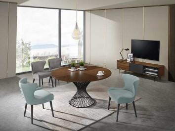 Designerski stół z okrągłym blatem i tapicerowane krzesła na drewnianych nogach