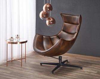 Obrotowy fotel ze skóry naturalnej oraz miedziany stolik kawowy z okrągłym blatem