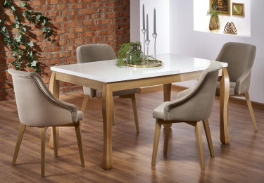 Stylowy stół na giętych nogach z połyskującym blatem oraz krzesła z podłokietnikami