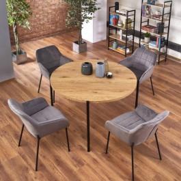 Stół do jadalni z okrągłym blatem oraz tapicerowane krzesła na metalowych nogach