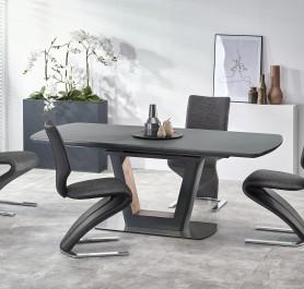 Stół do jadalni na nodze w kształcie litery V oraz krzesła na płozach