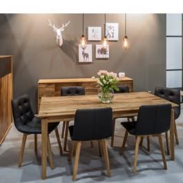 Wiszące lampy w stylu industrialnym oraz pikowane krzesła i drewniany stół z prostokątnym blatem