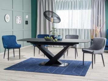 Szklany stół rozkładany z krzesłami tapicerowanymi tkaniną aksamitną w otwartej jadalni