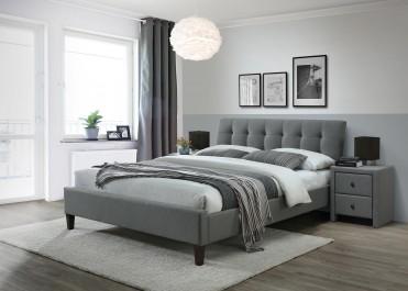 Szare łóżko sypialniane na czarnych nogach z pikowanym wezgłowiem i tapicerowane szafki nocne