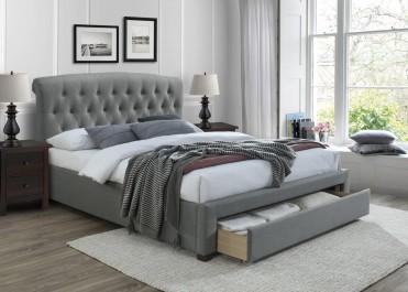 Dwuosobowe łóżko tapicerowane z wysokim zagłówkiem pikowanym i wysuwaną szufladą