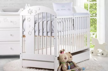Białe łóżeczko niemowlęce z szufladą na pościel Radek VII 120x60